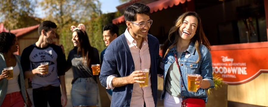 Couple enjoys Food and & wine Festival at Disneyland