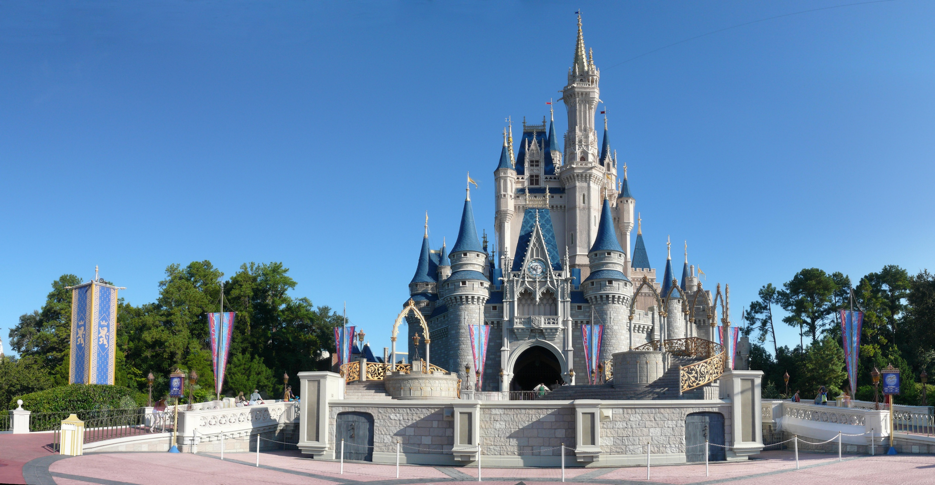 Magic Kingdom's Cinderella Castle in front of a light blue sky