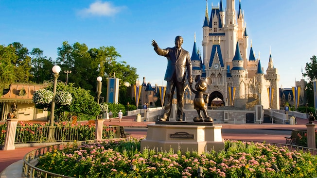 Cinderella Castle during the daytime with the partners statue