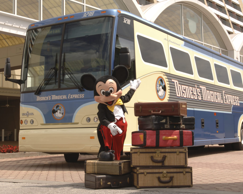 Mickey Mouse in front of a bus- Last Minute Disney World trip planning guide