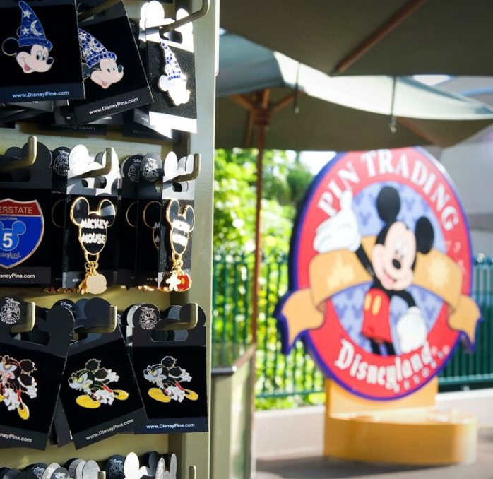 Image of pins with Disneyland pin trading logo